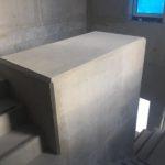 Bijgewerkte centrale koker trappenhal - esthetische betonherstelling